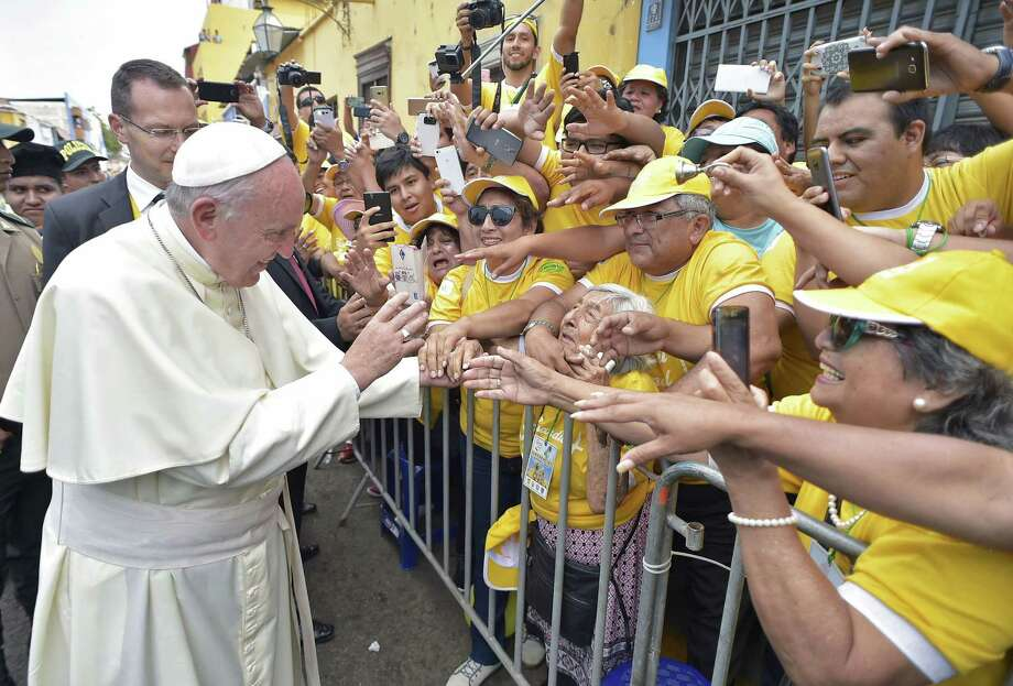 "Handout picture released by Osservatore Romano shows Pope Francis greeting crowds in the Peruvian city of Trujillo, on January 20, 2018. Pope Francis condemned ""organized crime"" and prayed for flood victims during a giant open air mass at a beach in Trujillo, Peru's crime-plagued largest northern coastal city. Francis acknowledged the ""insecurity"" due to the high crime rate in the region, still struggling to rebuild after deadly devastating floods one year ago. / AFP PHOTO / OSSERVATORE ROMANO / HO / RESTRICTED TO EDITORIAL USE - MANDATORY CREDIT ""AFP PHOTO / OSSERVATORE ROMANO"" - NO MARKETING NO ADVERTISING CAMPAIGNS - DISTRIBUTED AS A SERVICE TO CLIENTS  HO/AFP/Getty Images Photo: HO / AFP"