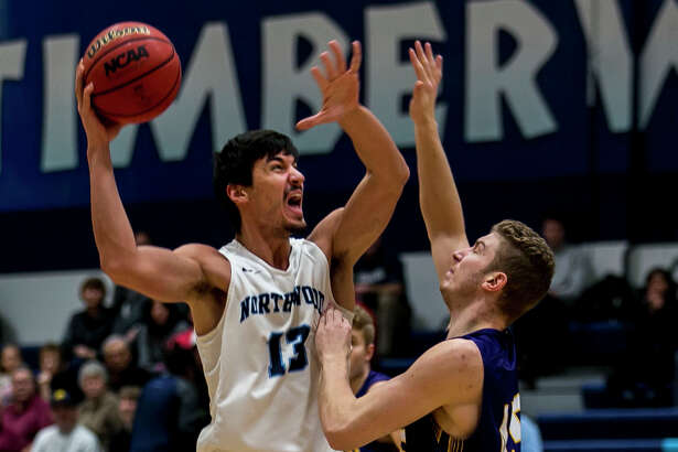 Northwood's David Jelinek yells as he shoots past Ashland's Teddy Metzen during a game against Ashland on Saturday, Jan. 20, 2018 at Northwood University. (Josie Norris/for the Daily News)
