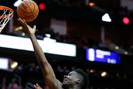 Houston Rockets center Clint Capela (15) shoots a layup against the Golden State Warriors during the second quarter of an NBA basketball game at Toyota Center on Saturday, Jan. 20, 2018, in Houston. ( Brett Coomer / Houston Chronicle )