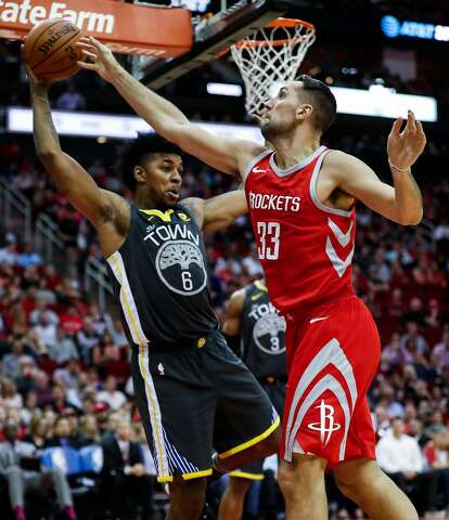 a07444f27bf1 Ryan Anderson knocks the ball away from Warriors guard Nick Young in  Houston s home win.