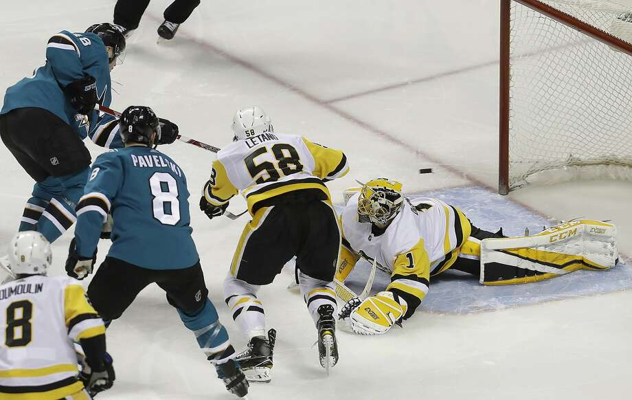 Sharks center Tomas Hertl (top left) scores the tie-breaking goal past Penguins goalie Casey DeSmith (1) during a power play to give San Jose a win over the defending Cup champions. Photo: Jeff Chiu, Associated Press