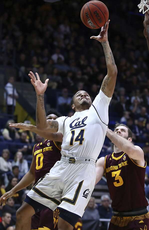 California's Don Coleman (14) lays up a shot past Arizona State's Tra Holder, left, and Mickey Mitchell (3) during the first half of an NCAA college basketball game Saturday, Jan. 20, 2018, in Berkeley, Calif. (AP Photo/Ben Margot) Photo: Ben Margot, Associated Press