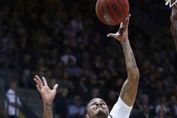 California's Don Coleman (14) lays up a shot past Arizona State's Tra Holder, left, and Mickey Mitchell (3) during the first half of an NCAA college basketball game Saturday, Jan. 20, 2018, in Berkeley, Calif. (AP Photo/Ben Margot)