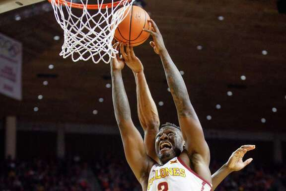Iowa State's Cameron Lard, left, grabs a rebound over Texas Tech's Norense Odiase during the second half of Saturday's game in Ames, Iowa.