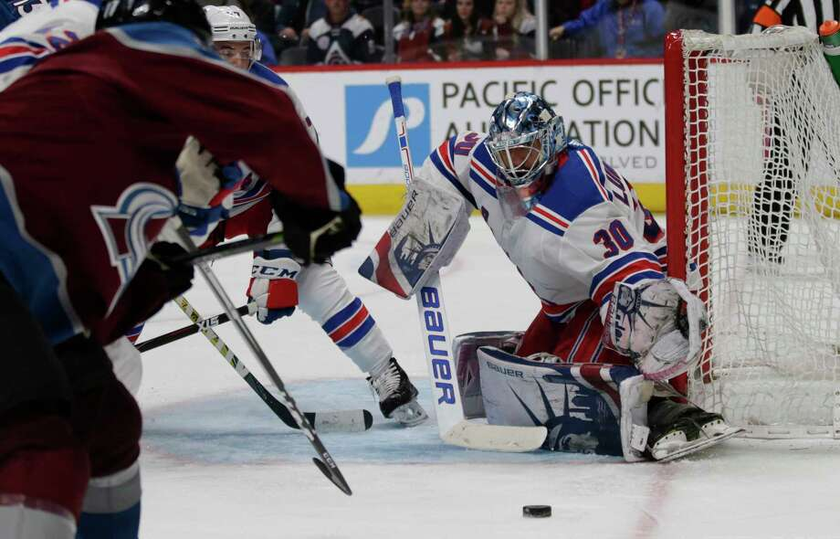 New York Rangers goaltender Henrik Lundqvist (30) watches the puck against the Colorado Avalanche in the third period of an NHL hockey game in Denver on Saturday, Jan. 20, 2018. Colorado won 3-1. The Avalanche have won nine games in a row.(AP Photo/Joe Mahoney) Photo: Joe Mahoney / FR170458 AP