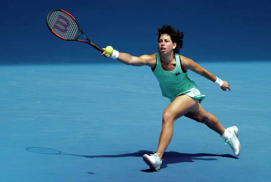 Spain's Carla Suarez Navarro stretches out for a return shot to Anett Kontaveit of Estonia during their fourth round match at the Australian Open tennis championships in Melbourne, Australia, Sunday, Jan. 21, 2018. (AP Photo/Dita Alangkara) Photo: Dita Alangkara / Copyright 2018 The Associated Press. All rights reserved.