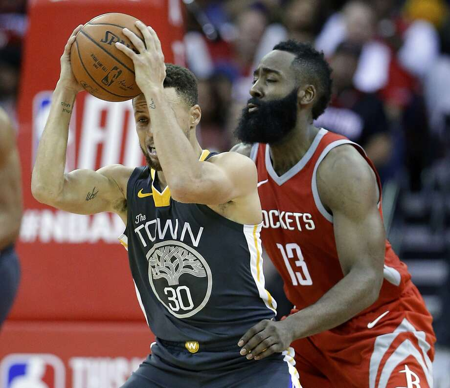 Stephen Curry was held to 19 points by Rockets guard James Harden and others in the Warriors' loss on Saturday night. Photo: Michael Wyke, Associated Press