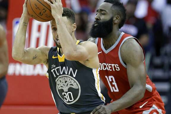 Golden State Warriors guard Stephen Curry (30) looks to pass the ball under pressure from Houston Rockets guard James Harden (13) during the second half of an NBA basketball game Saturday, Jan. 20, 2018, in Houston. (AP Photo/Michael Wyke)