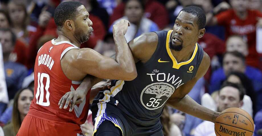 Golden State Warriors forward Kevin Durant (35) looks to pass the ball under pressure from Houston Rockets guard Eric Gordon (10) during the second half of an NBA basketball game Saturday, Jan. 20, 2018, in Houston. (AP Photo/Michael Wyke) Photo: Michael Wyke/Associated Press