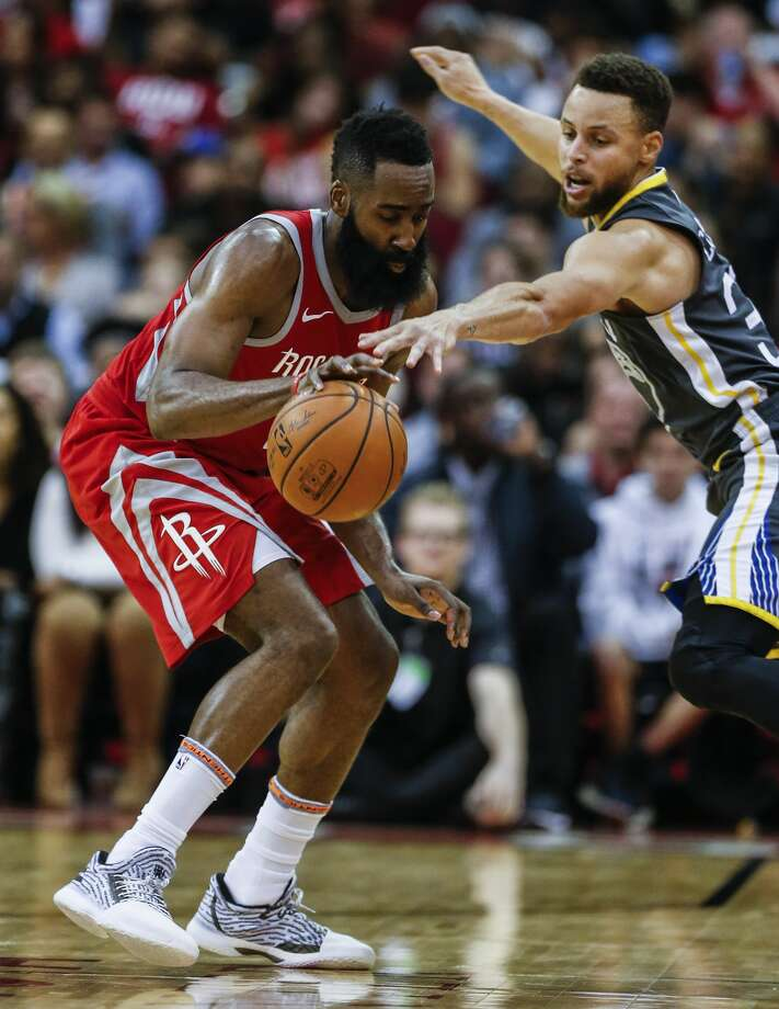Houston Rockets guard James Harden (13) and Golden State Warriors guard Stephen Curry (30) go after a loose ball during the second half of an NBA basketball game at Toyota Center on Saturday, Jan. 20, 2018, in Houston. ( Brett Coomer / Houston Chronicle ) Photo: Brett Coomer/Houston Chronicle