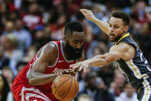 Houston Rockets guard James Harden (13) and Golden State Warriors guard Stephen Curry (30) go after a loose ball during the second half of an NBA basketball game at Toyota Center on Saturday, Jan. 20, 2018, in Houston. ( Brett Coomer / Houston Chronicle )