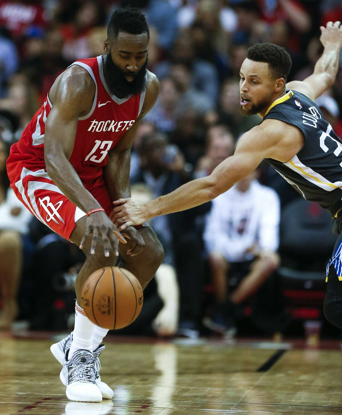 Golden State Warriors guard Stephen Curry (30) grabs Houston Rockets guard James Harden's arm as he tries to go for a steal during the second half of an NBA basketball game at Toyota Center on Saturday, Jan. 20, 2018, in Houston. ( Brett Coomer / Houston Chronicle )