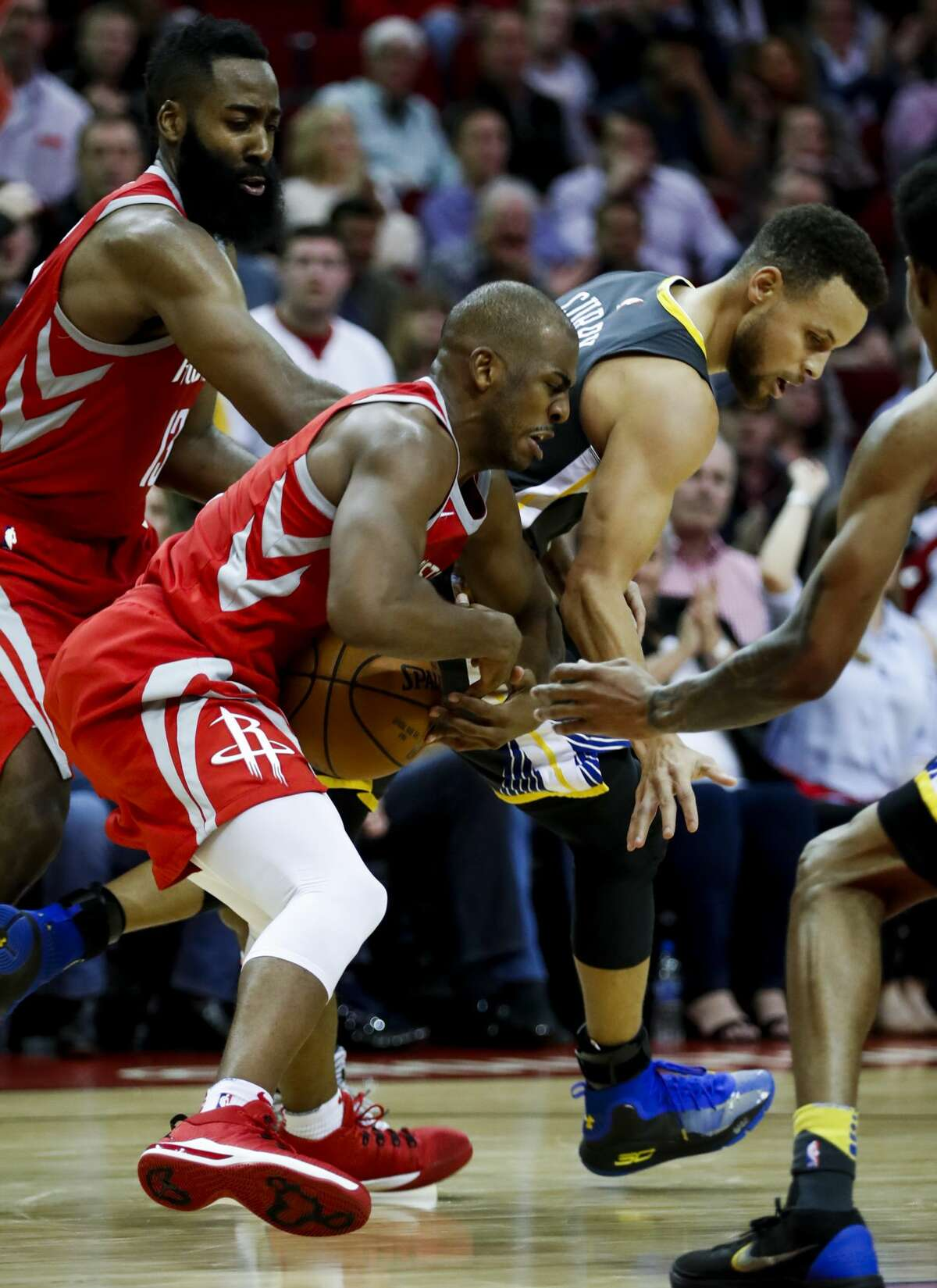 Houston Rockets guard Chris Paul (3) takes the ball from Golden State Warriors guard Stephen Curry (30) during the fourth quarter of an NBA basketball game at Toyota Center on Saturday, Jan. 20, 2018, in Houston. ( Brett Coomer / Houston Chronicle )