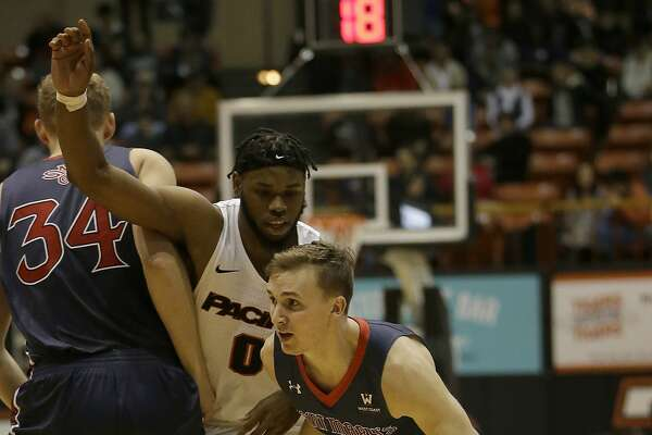 St. Mary's guard Emmett Naar, right, drives against Pacific forward Jahlil Tripp during the first half of an NCAA college basketball game Saturday, Jan. 20, 2018, in Stockton, Calif. (AP Photo/Rich Pedroncelli)
