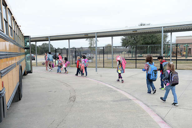 China Elementary School students board their buses at the end of the day Friday. School districts throughout the area are tasked with making up the recent loss of days due to weather on top of the time lost in the wake of Harvey. Photo taken Friday, January 19, 2018 Kim Brent/The Enterprise