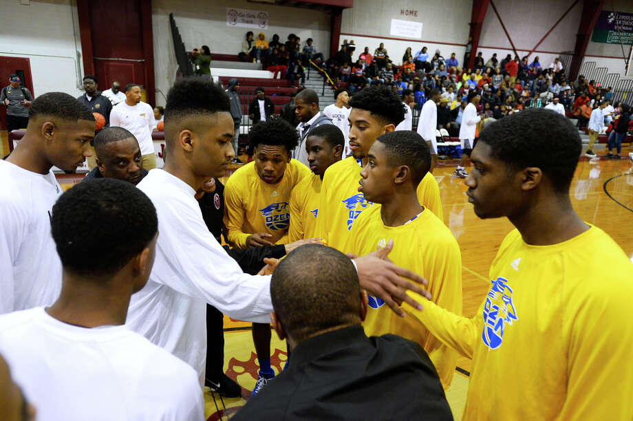 Central and Ozen captains meet before their basketball game on Friday night.  Photo taken Friday 1/19/18 Ryan Pelham/The Enterprise Photo: Ryan Pelham / ©2017 The Beaumont Enterprise/Ryan Pelham