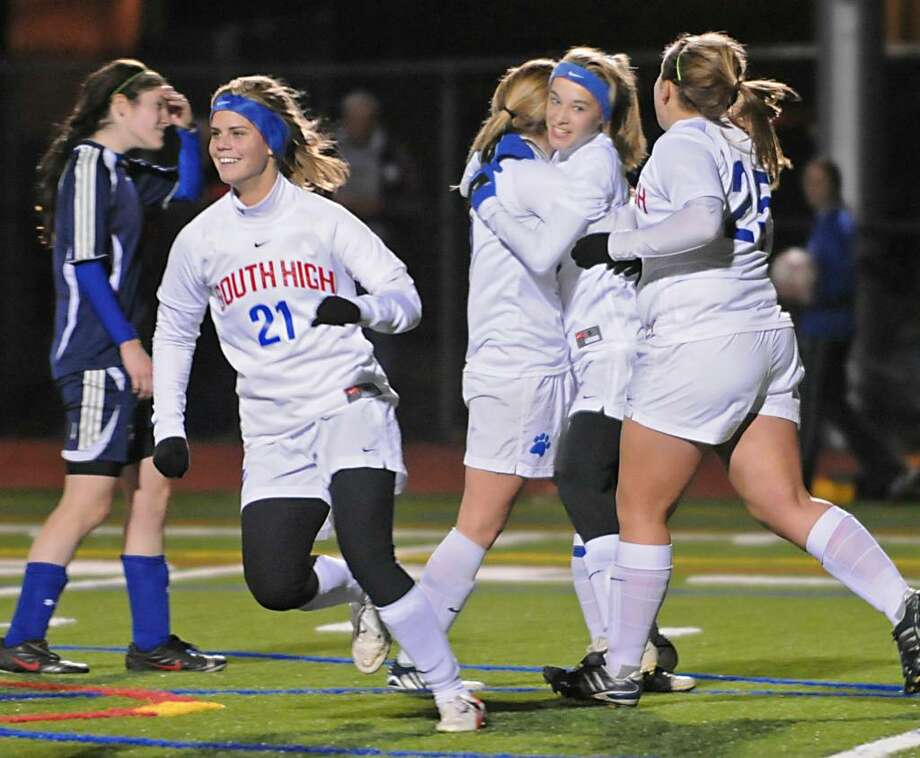 Sam Blizzard, second from right, of South Glens Falls, gets hugs from teammates after she scored a game-tying goal against Holy Names in the first half. Blizzard added another goal in the second half. (Lori Van Buren/Times Union Photo: LORI VAN BUREN