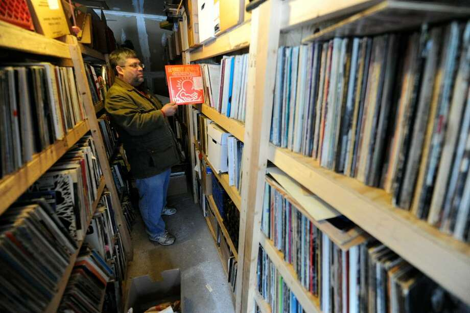 Paul Forshey shows off some of his extensive record collection. (Skip Dickstein/ Times Union) Photo: SKIP DICKSTEIN / 2008