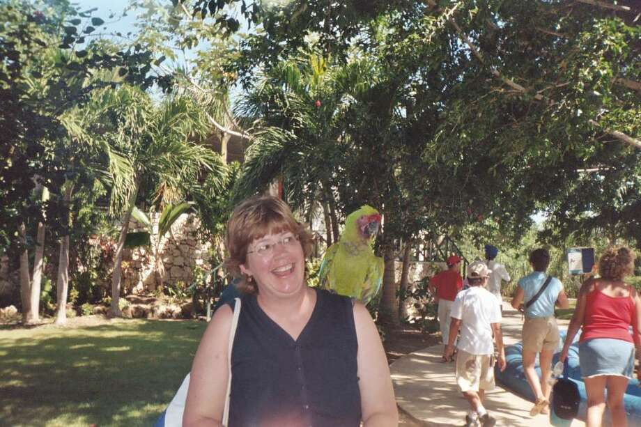 Anne Merrigan finds a feathered friend in Key West, Fla. (Fred Semmens) Photo: Fred Semmens