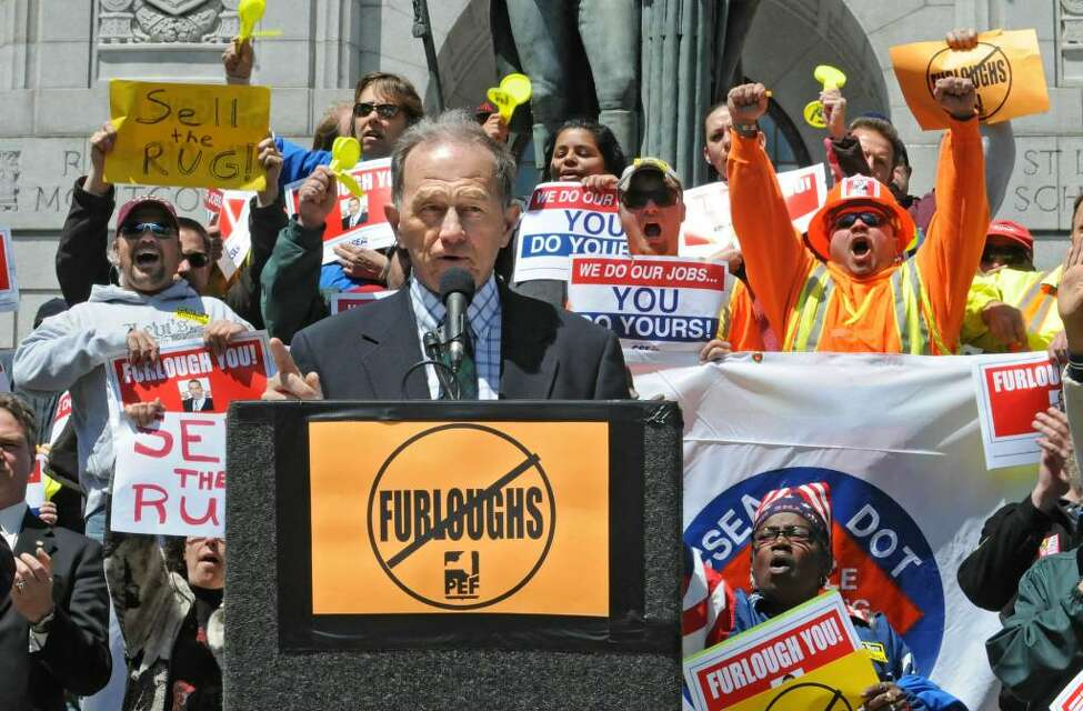 During a protest outside the Capitol in Albany today, Assemblyman Robert Reilly tells state employees that he will be voting no on the governor's plan to furlough state employees to balance the budget. (Lori Van Buren / Times Union)