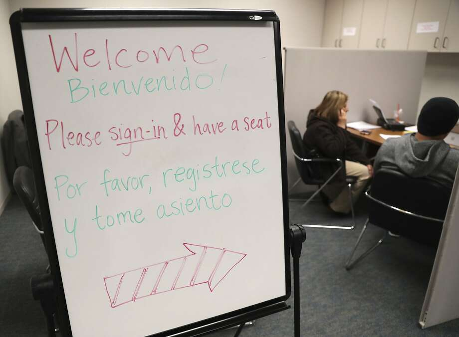 Clients seek assistance at Community Council, a nonprofit in Dallas that specializes in health care enrollment for low-income families. Photo: LM Otero, Associated Press