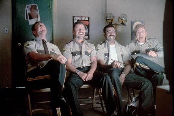 "Super Troopers.  HOUCHRON CAPTION  (02/15/2002):  Erik Stolhanske, from left, Steve Lemme, Jay Chandrasekhar and Paul Soter play Vermont highway patrolmen in the goofball comedy ""Super Troopers."""