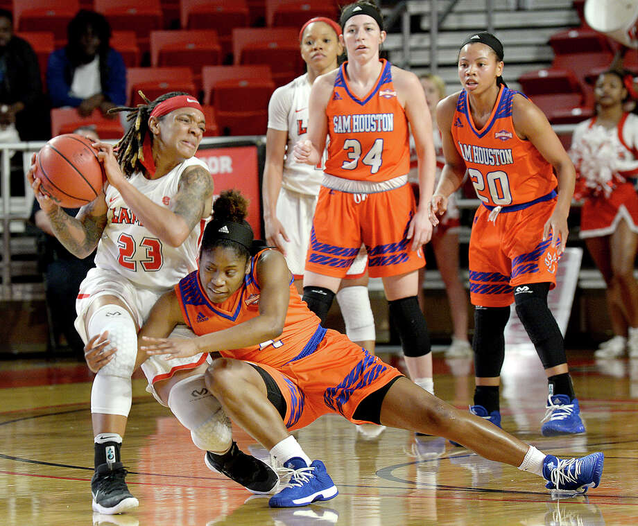Lamar's Moe Kinard tries to break away from Sam Houston State's Jada Ballew after getting control of the loose ball during their match-up at the Montagne Center Saturday. The Lady Cardinals were aiming to continue their winning streak and set a school record. Photo taken Saturday, January 20, 2018 Kim Brent/The Enterprise Photo: Kim Brent / BEN