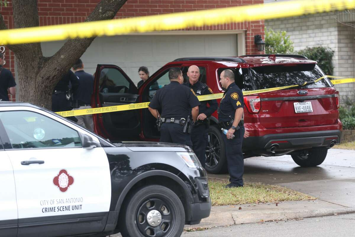 San Antonio Police investigate the scene where a woman was shot dead at 10428 Arbor Bluff, Sunday, Jan. 21, 2018. Police issued a lookout for the suspect, Richard Concepcion, 37, who was driving at white Toyota Tundra with GH58MH. He is believed to have an 18-month-old child with him.