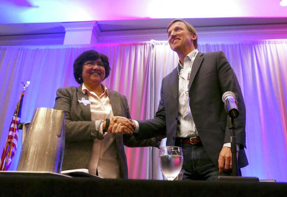 Democratic gubernatorial candidates Lupe Valdez, left, and Andrew White shake hands after taking part in a forum at Texas AFL-CIO's COPE convention in Austin in January. Valdez and White will face off in the May 22 runoff for the Democratic gubernatorial nomination, but Gov. Greg Abbott already is acting as if Valdez is the nominee, all but ignoring White. Photo: Billy Calzada /San Antonio Express-News / San Antonio Express-News