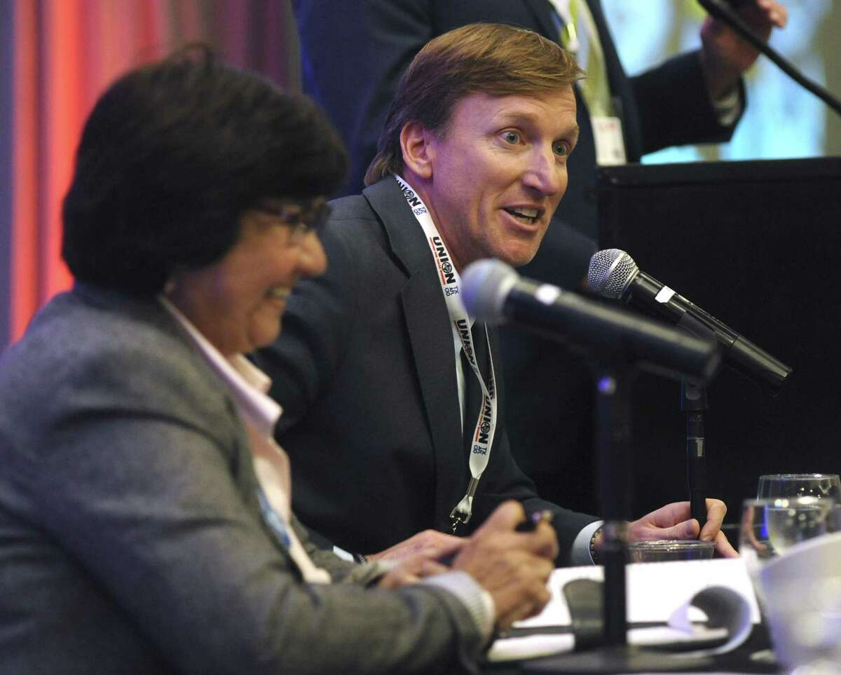 Democratic gubernatorial candidate Andrew White, right, speaks as fellow candidate Lupe Valdez, left, listens at a forum at Texas AFL-CIO's COPE convention at the Sheraton Austin hotel on Saturday, Jan. 20, 2018.