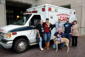 Volunteers with People and Animals Working in Spirit (P.A.W.S.), Griffin Hospital's Pet Therapy Program, and Connecticut Emergency Animal Response Service (EARS) pose during a meet and greet event at Griffin Hospital in Derby, on Saturday June 17, 2017. The two groups will host a pet first aid class on Jan. 27 at the hospital, 130 Division St., Derby.