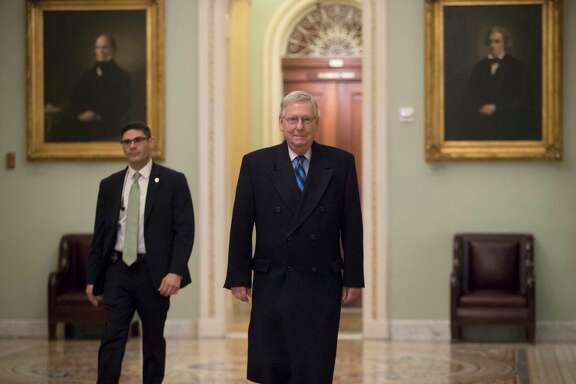 Senate Majority Leader Mitch McConnell, R-Ky., returns to his office as the federal shutdown enters Day 2 amid a partisan blame game on both sides, at the Capitol in Washington, Sunday, Jan. 21, 2018.