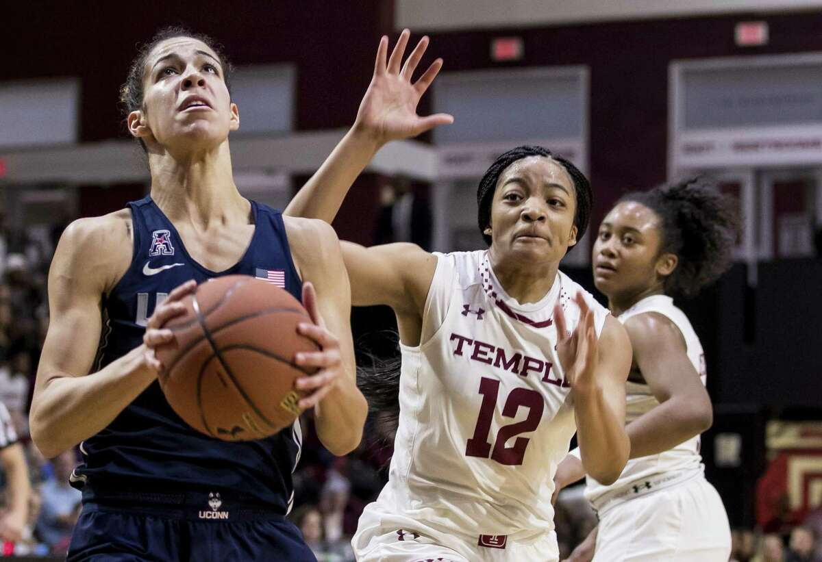 UConn's Kia Nurse, left, looks to go for the shot as Temple's Emani Mayo gives chase Sunday in Philadelphia.