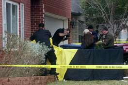 San Antonio Police investigate the scene where a woman was shot dead at 10428 Arbor Bluff, Sunday, Jan. 21, 2018. Police issued a lookout for the suspect, Richard Concepcion, 37, who was driving at white Toyota Tundra and was with hi 18-month-old son. He was later found with a gunshot with a self-inflicted gunshot in Guadalupe County and his son was found safe.
