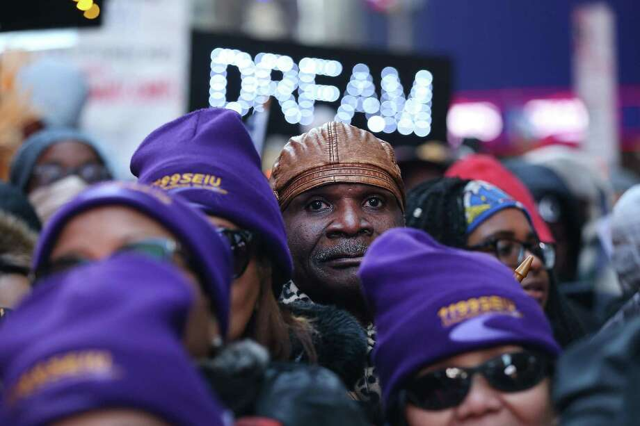 The fate of some 800,000 Dreamers depends on whether congressional Democrats can reach a deal with President Trump. There's an easy path to that deal — agree to Trump's wall. Here, hundreds of people, many of them Haitian, demonstrate against Trump's recent comment that jeopardize such a deal. Photo: Spencer Platt /Getty Images / 2018 Getty Images
