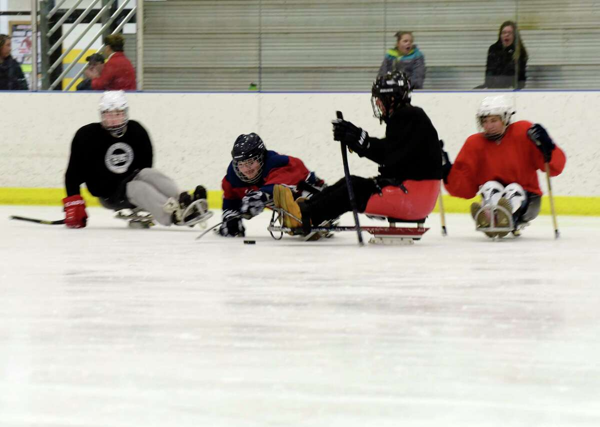Members of the Capital District STRIDE Sled Warriors hockey team take part in practice at the Albany County Hockey Facility on Sunday, Jan. 21, 2018, in Albany, N.Y. The sled hockey team, which was started ten years ago, will compete in the winter Empire State Games in Lake Placid in early February. Last year the STRIDE hockey team took home the Bronze Medal. This years team is made up of 18 players. The STRIDE Adaptive Sports hockey team is comprise of those with mental or physical disabilities or combat injured veterans. Anyone interested in joining the team can email STRIDE's program director, Megan Evans, mevans@stride.org. (Paul Buckowski/Times Union)