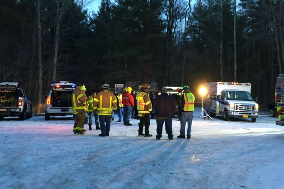 Rescuers pull a 22-year-old man out of the Plotter Kill preserve on Sunday. They say he slipped down the side of a waterfall at the Rotterdam nature preserve. His ankle was injured and officials said they were unsure if there were additional injuries.