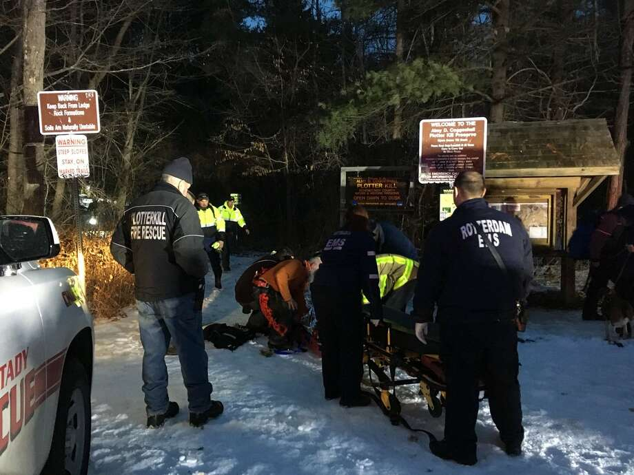 Rescuers pull a 22-year-old man out of the Plotter Kill preserve on Sunday. They say he slipped down the side of a waterfall at the Rotterdam nature preserve. His ankle was injured and officials said they were unsure if there were additional injuries.  Photo: Wendy Liberatore / Times Union