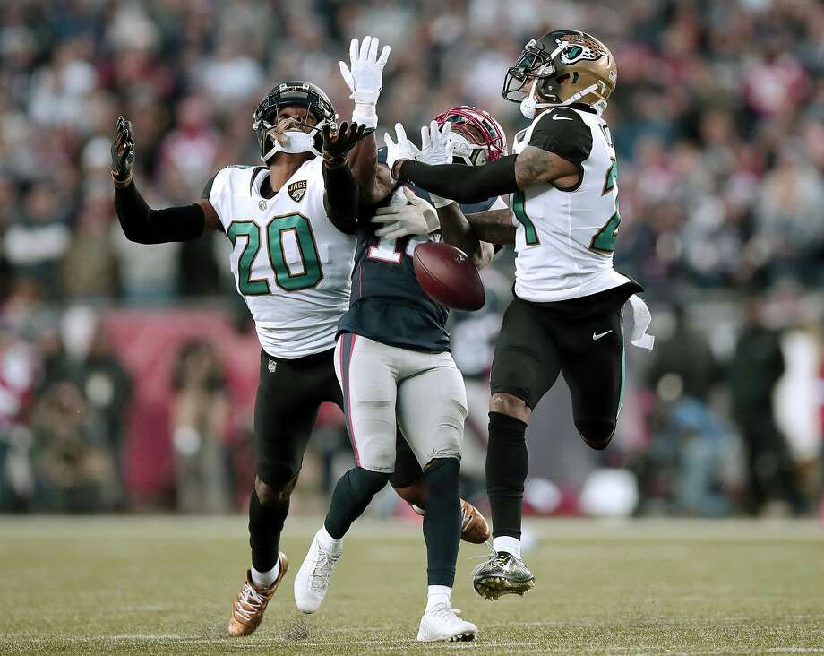 Jacksonville Jaguars cornerbacks Jalen Ramsey (20) and A.J. Bouye (21) break up a pass intended for New England Patriots wide receiver Brandin Cooks (14) during the second half of the AFC championship NFL football game, Sunday, Jan. 21, 2018, in Foxborough, Mass. (AP Photo/Charles Krupa) Photo: Charles Krupa, Associated Press