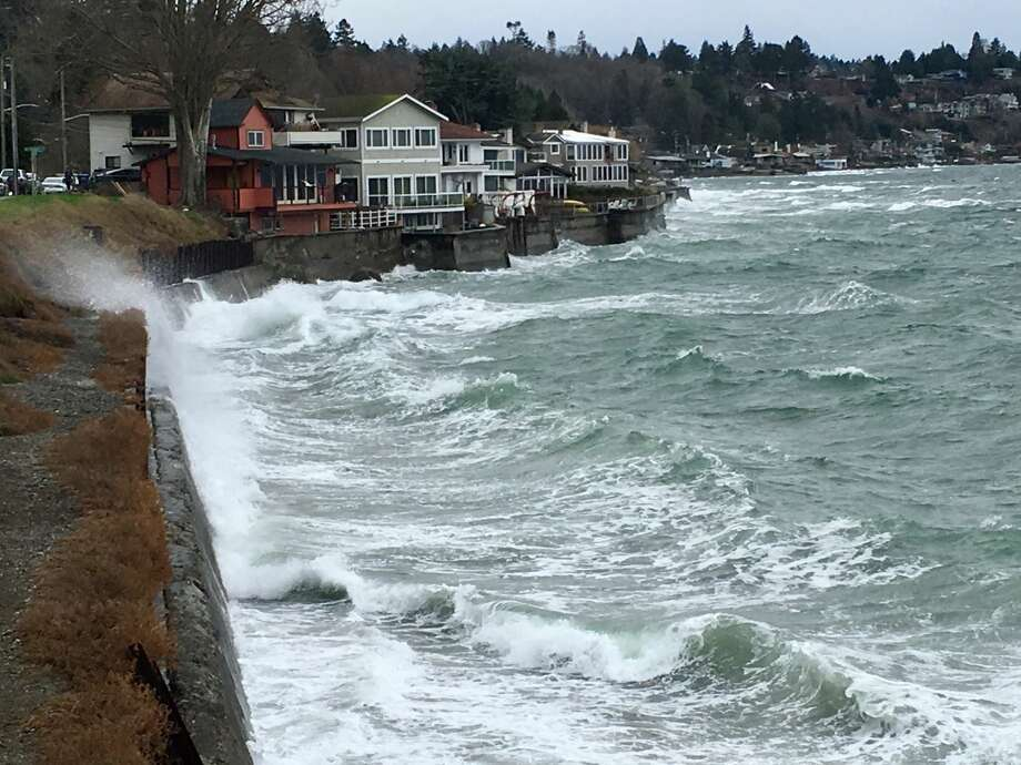 Waves crash against the breakwall in West Seattle north of Alki Beach on Sunday, Jan. 21, 2018. Photo: Daniel DeMay/SeattlePI