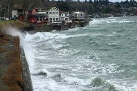SeattlePI file: Waves crash against the breakwall in West Seattle north of Alki Beach on Sunday, Jan. 21, 2018.