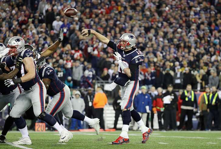 FOXBOROUGH, MA - JANUARY 21: Tom Brady #12 of the New England Patriots throws in the fourth quarter during the AFC Championship Game against the Jacksonville Jaguars at Gillette Stadium on January 21, 2018 in Foxborough, Massachusetts.  (Photo by Maddie Meyer/Getty Images)