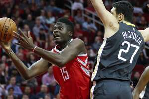 Houston Rockets center Clint Capela (15) shoots around the defense of Golden State Warriors center Zaza Pachulia (27) during the first quarter of an NBA basketball game at Toyota Center on Saturday, Jan. 20, 2018, in Houston. ( Brett Coomer / Houston Chronicle )