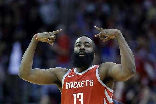 Houston Rockets guard James Harden (13) celebrates a three point shot during the first half of an NBA basketball game against the Golden State Warriors Saturday, Jan. 20, 2018, in Houston. (AP Photo/Michael Wyke)