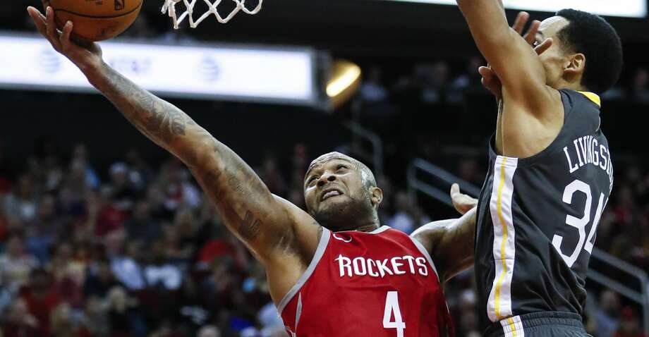 Houston Rockets forward PJ Tucker (4) shoots a layup past Golden State Warriors guard Shaun Livingston (34) during the second quarter of an NBA basketball game at Toyota Center on Saturday, Jan. 20, 2018, in Houston. ( Brett Coomer / Houston Chronicle ) Photo: Brett Coomer/Houston Chronicle