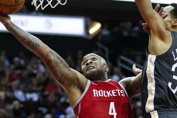 Houston Rockets forward PJ Tucker (4) shoots a layup past Golden State Warriors guard Shaun Livingston (34) during the second quarter of an NBA basketball game at Toyota Center on Saturday, Jan. 20, 2018, in Houston. ( Brett Coomer / Houston Chronicle )