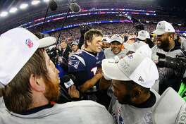 FOXBOROUGH, MA - JANUARY 21:  Tom Brady #12 of the New England Patriots celebrates with teammates after winning the AFC Championship Game against the Jacksonville Jaguars at Gillette Stadium on January 21, 2018 in Foxborough, Massachusetts.  (Photo by Maddie Meyer/Getty Images)