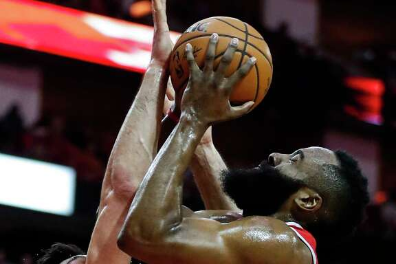 Houston Rockets guard James Harden (13) shoots over Golden State Warriors center Zaza Pachulia (27) during the first quarter of an NBA basketball game at Toyota Center on Saturday, Jan. 20, 2018, in Houston. ( Brett Coomer / Houston Chronicle )