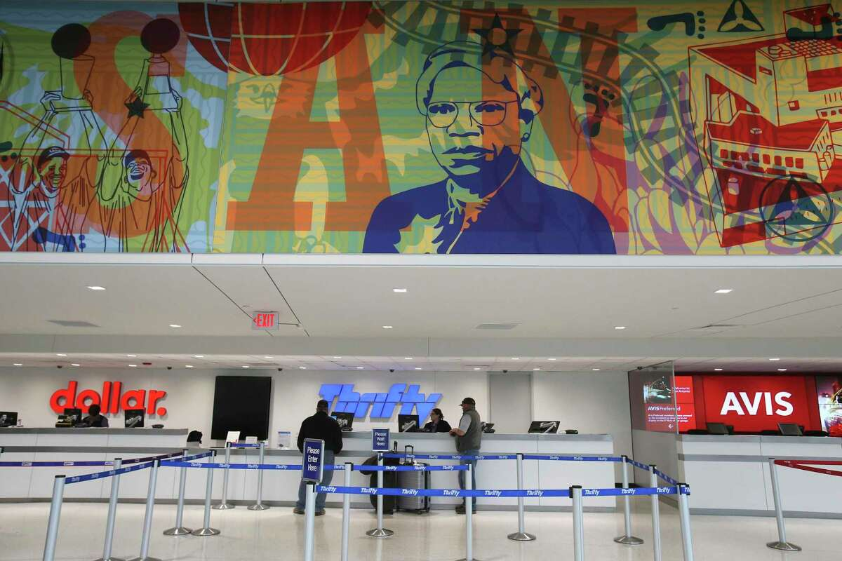An image of Artemisia Bowden, founder and president of St. Philip's College, is part of a mural that adorns the Customer Service Bay of the new $178 million consolidated rental car facility at the San Antonio International Airport on Jan. 21, 2018. A public art project called Ádelante San Antonio! adorns the inside and outside of the facility. The 35-foot tall triptych, created by Dos Mestizx: Suzy González and Michael Menchaca, depicts how the city has transformed over the past 300 years in honor of San Antonio's Tricentennial. On the lower left of the mural are images of San Antonio Spurs David Robinson and Tim Duncan.