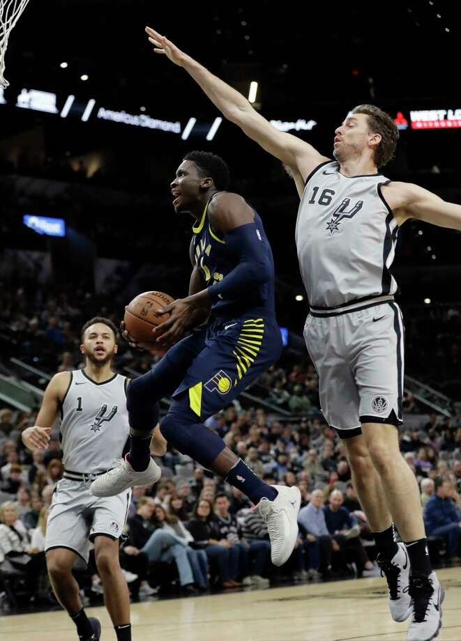 Indiana Pacers guard Victor Oladipo (4) drives to the basket past San Antonio Spurs center Pau Gasol (16) during the first half of an NBA basketball game, Sunday, Jan. 21, 2018, in San Antonio. (AP Photo/Eric Gay) Photo: Eric Gay, Associated Press / Copyright 2018 The Associated Press. All rights reserved.